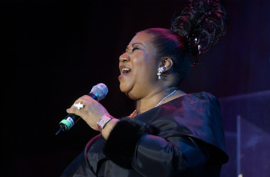 NEW YORK - FEBRUARY 22:  Singer Aretha Franklin performs onstage during Clive Davis' pre-Grammy Gala at the Regency Hotel's Grand Ballroom February 22, 2003 in New York City.  (Photo by Frank Micelotta/Getty Images)