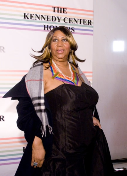 WASHINGTON - DECEMBER 06: Aretha Franklin poses for photographer on the red carpet before the 32nd Kennedy Center Honors at Kennedy Center Hall of States on December 6, 2009 in Washington, DC. (Photo by Kris Connor/Getty Images)