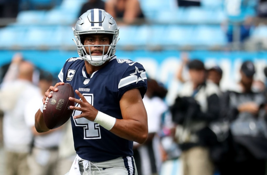 CHARLOTTE, NC - SEPTEMBER 09: Dak Prescott #4 of the Dallas Cowboys throws a warm up pass before their game against the Carolina Panthers at Bank of America Stadium on September 9, 2018 in Charlotte, North Carolina.  (Photo by Streeter Lecka/Getty Images)