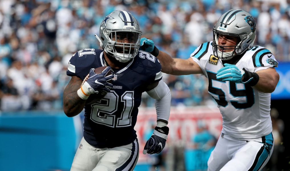 CHARLOTTE, NC - SEPTEMBER 09:  Ezekiel Elliott #21 of the Dallas Cowboys runs the ball against Luke Kuechly #59 of the Carolina Panthers in the first quarter during their game at Bank of America Stadium on September 9, 2018 in Charlotte, North Carolina.  (Photo by Streeter Lecka/Getty Images)