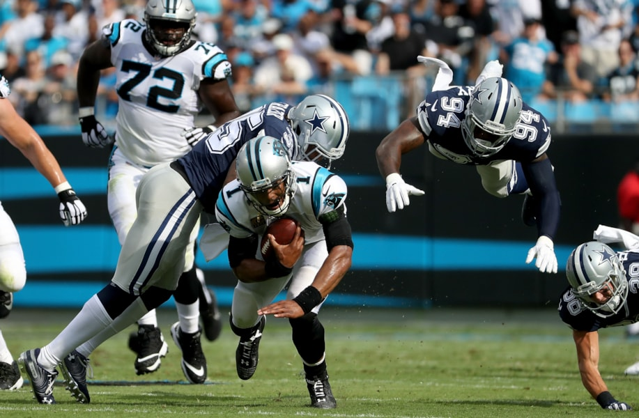 CHARLOTTE, NC - SEPTEMBER 09:  Cam Newton #1 of the Carolina Panthers runs the ball against Randy Gregory #94 of the Dallas Cowboys in the first quarter during their game at Bank of America Stadium on September 9, 2018 in Charlotte, North Carolina.  (Photo by Streeter Lecka/Getty Images)