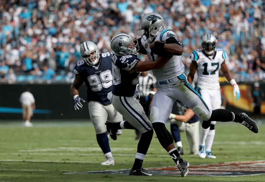 CHARLOTTE, NC - SEPTEMBER 09:  Cam Newton #1 of the Carolina Panthers runs  the ball against Jeff Heath #38 of the Dallas Cowboys in the first quarter during their game at Bank of America Stadium on September 9, 2018 in Charlotte, North Carolina.  (Photo by Streeter Lecka/Getty Images)