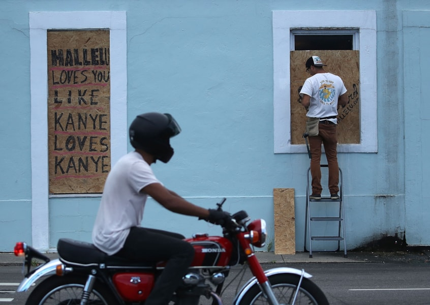 WRIGHTSVILLE BEACH, NC- SEPTEMBER 11: Windows are boarded up as local shops prepare for the arrival of Hurricane Florence on September 11, 2018 in Wrightsville Beach, United States. Hurricane Florence is expected on Friday possibly as a category 4 storm along the Virginia, North Carolina and South Carolina coastline.  (Photo by Mark Wilson/Getty Images)