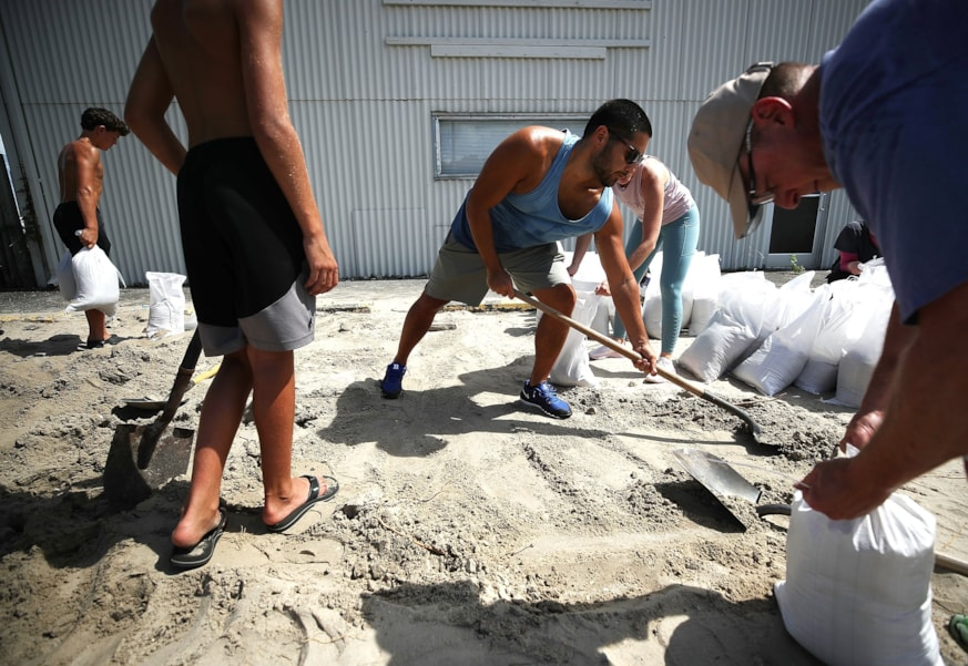 WRIGHTSVILLE BEACH, NC- SEPTEMBER 11: Local residents fill sand bags that was provided by the town as they prepare for the arrival of Hurricane Florence on September 11, 2018 in Wrightsville Beach, United States. Hurricane Florence is expected on Friday possibly as a category 4 storm along the Virginia, North Carolina and South Carolina coastline.  (Photo by Mark Wilson/Getty Images)