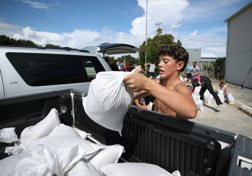 WRIGHTSVILLE BEACH, NC- SEPTEMBER 11: Local resident Dave Collins loads a sand bag into a truck as the coastal area is preparing for the arrival of Hurricane Florence on September 11, 2018 in Wrightsville Beach, United States. Hurricane Florence is expected on Friday possibly as a category 4 storm along the Virginia, North Carolina and South Carolina coastline.  (Photo by Mark Wilson/Getty Images)
