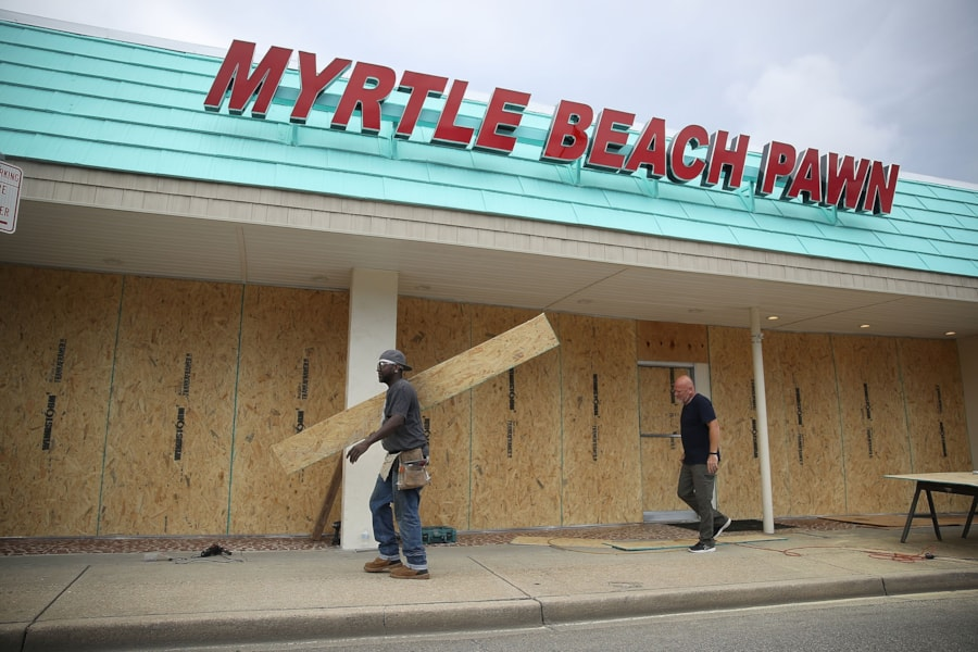 MYRTLE BEACH, SC - SEPTEMBER 11:  Jeff Bryant (L) and James Evans board the windows of a business ahead of the arrival of Hurricane Florence on September 11, 2018 in Myrtle Beach, South Carolina. Florence is expected to make landfall by late Thursday to near Category 5 strength along the Virginia, North Carolina and South Carolina coastline.  (Photo by Joe Raedle/Getty Images)