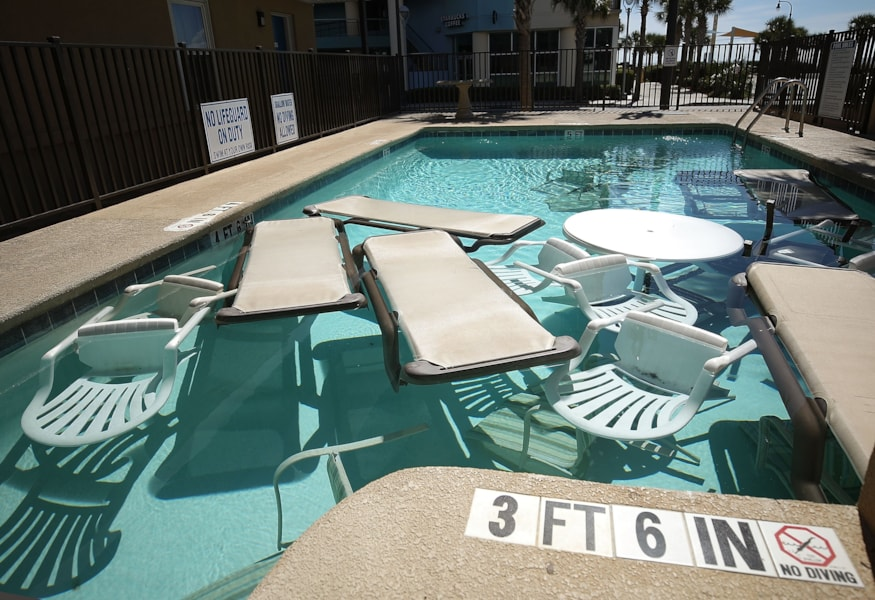 MRYTLE BEACH, SC. SEPTEMBER 12: Poolside furniture is placed in the pool of a hotel ahead of the approaching Hurricane Florence on September 12, 2018 in Mrytle Beach, South Carolina. Hurricane Florence is expected on Friday possibly as a category 4 storm along the Virginia, North Carolina and South Carolina coastline.  (Photo by Mark Wilson/Getty Images)