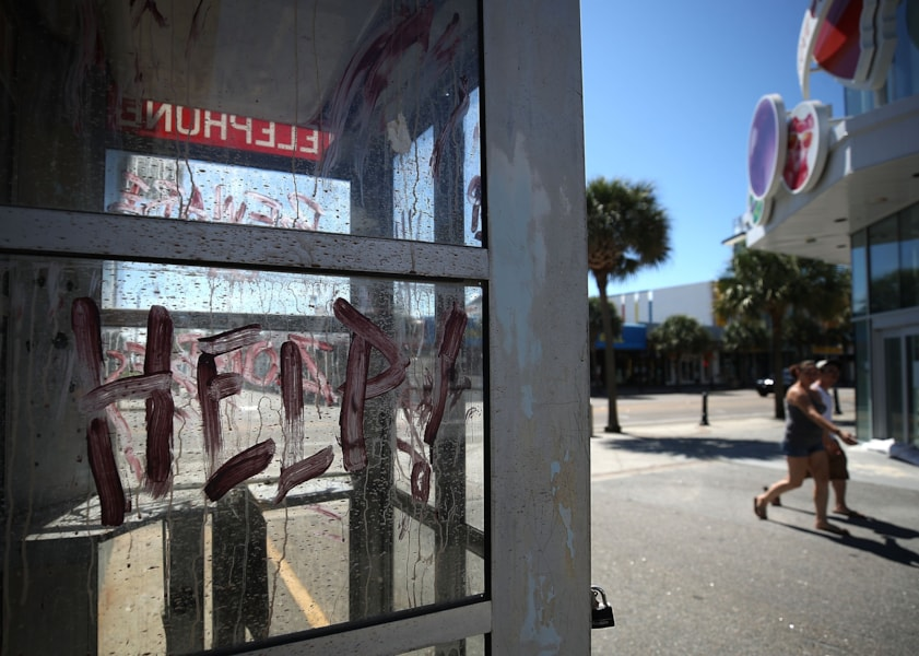MRYTLE BEACH, SC. SEPTEMBER 12: People walk along N. Ocean Blvd. while many hotels and businesses are closed and boarded up ahead of the approaching Hurricane Florence on September 12, 2018 in Myrtle Beach, South Carolina. Hurricane Florence is expected on Friday possibly as a category 4 storm along the Virginia, North Carolina and South Carolina coastline.  (Photo by Mark Wilson/Getty Images)