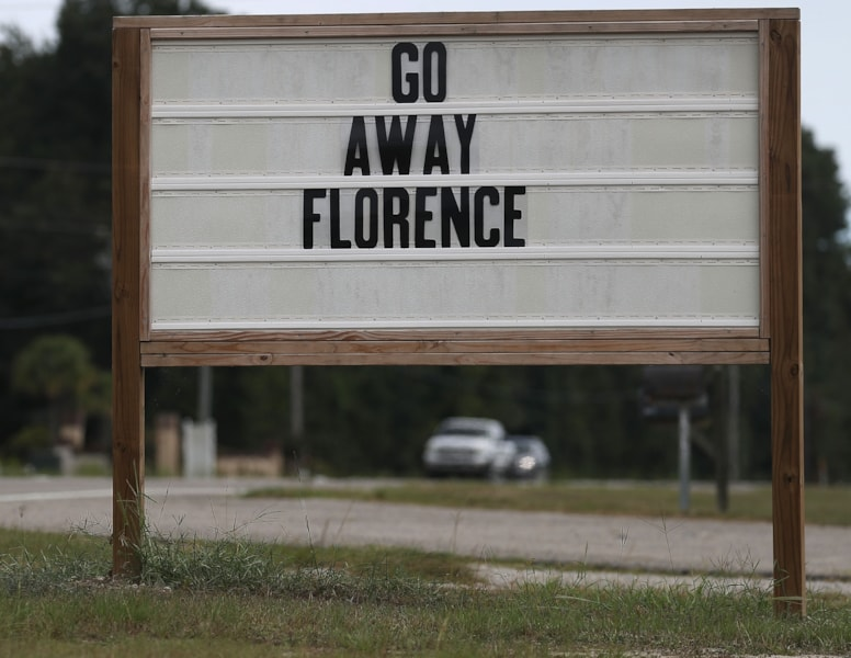 """MYRTLE BEACH, SC - SEPTEMBER 12:  A sign reads """"Go Away Florence"""" ahead of the arrival of Hurricane Florence on September 12, 2018 in Myrtle Beach, South Carolina. Florence slowed its approach to the U.S. today and was expected to turn south, stalling along the North Carolina and South Carolina coast and bringing with it torrential rain, high winds and a dangerous storm surge tomorrow through Saturday.   (Photo by Joe Raedle/Getty Images)"""