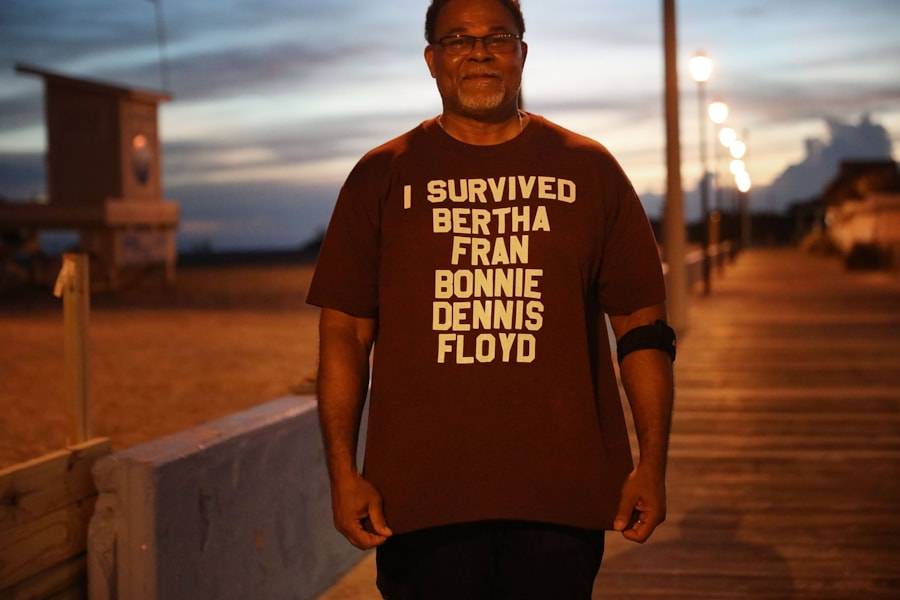 ATLANTIC BEACH, NC - SEPTEMBER 12:  Al Brookins of Haverlock, North Carolina, poses with his shirt that lists some of the previoius hurricanes he has lived through while taking a stroll on the beach before the arrival of Hurricane Florence September 12, 2018 in Atlantic Beach, North Carolina. Coastal cities in North Carolina, South Carolina and Virgnian are under evacuation orders as the category 3 hurricane approaches the United States.  (Photo by Chip Somodevilla/Getty Images)