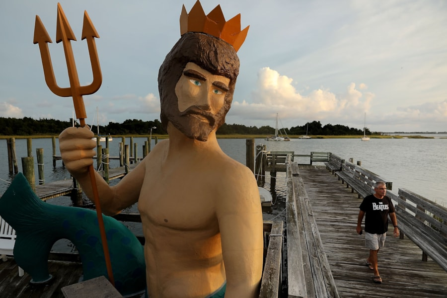 MOREHEAD CITY, NC - SEPTEMBER 12:  A large statue in the likeness of Poseidon, the Greek god of the oceans, stands along the boardwalk before the arrival of Hurricane Florence September 12, 2018 in Morehead City, North Carolina. Coastal cities in North Carolina, South Carolina and Virgnian are under evacuation orders as the category 3 hurricane approaches the United States.  (Photo by Chip Somodevilla/Getty Images)