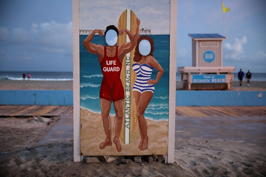 ATLANTIC BEACH, NC - SEPTEMBER 12:  People walk along the beach before the arrival of Hurricane Florence September 12, 2018 in Atlantic Beach, North Carolina. Coastal cities in North Carolina, South Carolina and Virgnian are under evacuation orders as the category 3 hurricane approaches the United States.  (Photo by Chip Somodevilla/Getty Images)