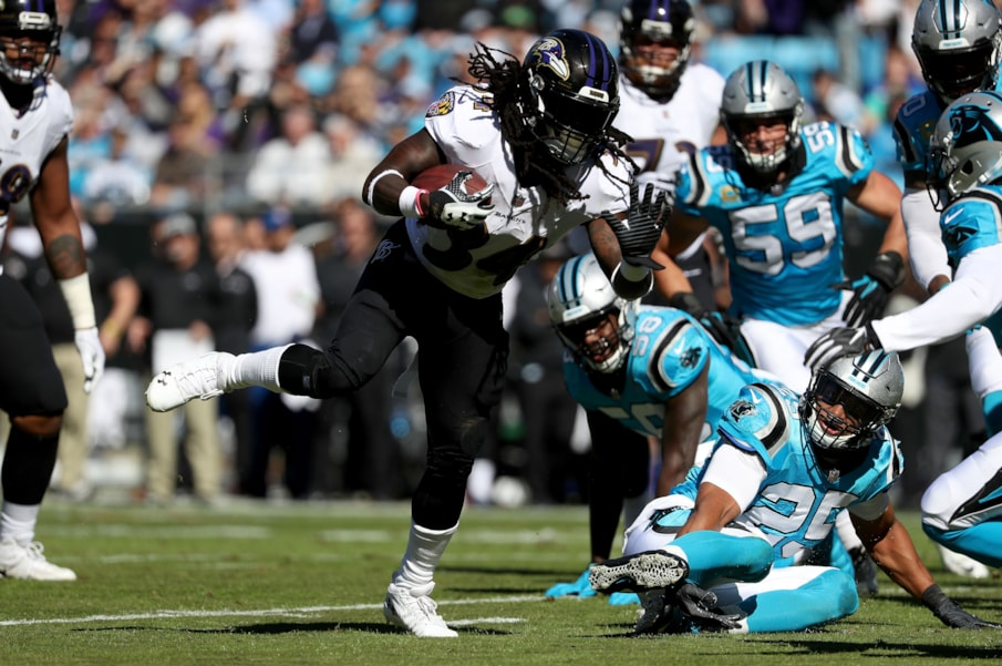 CHARLOTTE, NC - OCTOBER 28:  Alex Collins #34 of the Baltimore Ravens runs for a touchdown against the Carolina Panthers in the first quarter during their game at Bank of America Stadium on October 28, 2018 in Charlotte, North Carolina.  (Photo by Streeter Lecka/Getty Images)