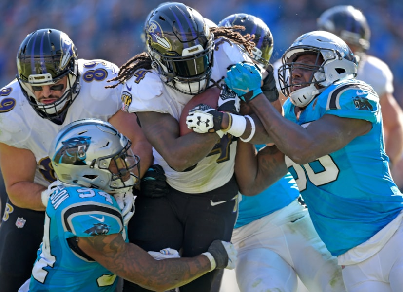 CHARLOTTE, NC - OCTOBER 28:  Shaq Green-Thompson #54 and Thomas Davis #58 of the Carolina Panthers tackle Alex Collins #34 of the Baltimore Ravens during their game at Bank of America Stadium on October 28, 2018 in Charlotte, North Carolina.  (Photo by Grant Halverson/Getty Images)