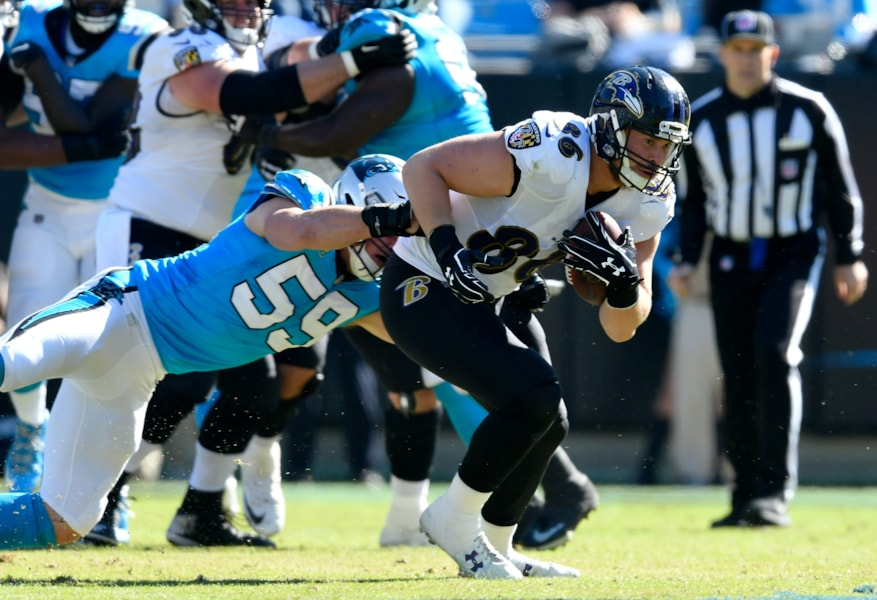CHARLOTTE, NC - OCTOBER 28:  Nick Boyle #86 of the Baltimore Ravens makes a catch against Luke Kuechly #59 of the Carolina Panthers during their game at Bank of America Stadium on October 28, 2018 in Charlotte, North Carolina.  (Photo by Grant Halverson/Getty Images)