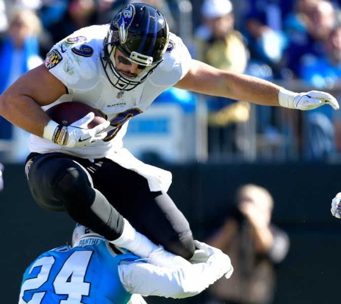 CHARLOTTE, NC - OCTOBER 28:  Mark Andrews #89 of the Baltimore Ravens hurdles James Bradberry #24 of the Carolina Panthers during their game at Bank of America Stadium on October 28, 2018 in Charlotte, North Carolina.  (Photo by Grant Halverson/Getty Images)