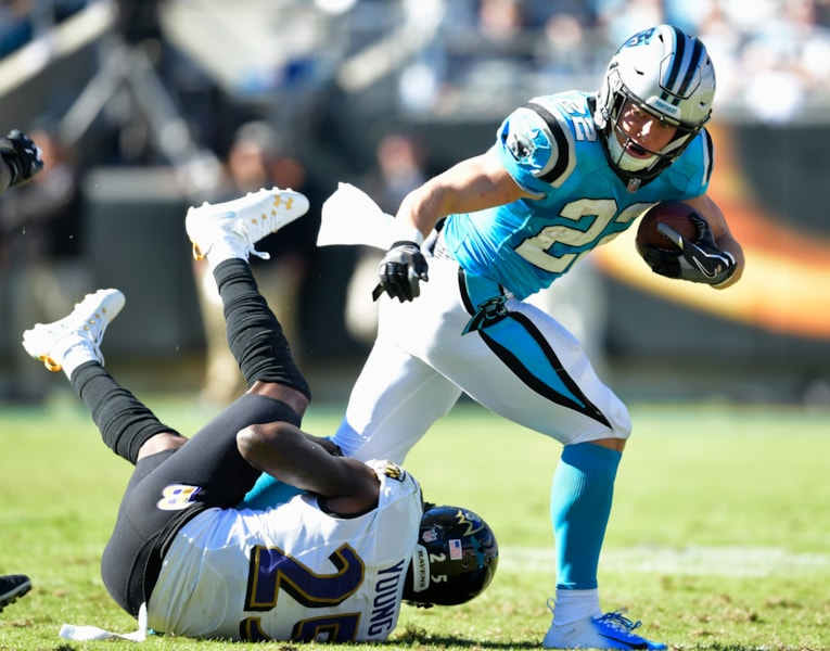 CHARLOTTE, NC - OCTOBER 28: Christian McCaffrey #22 of the Carolina Panthers runs over Tavon Young #25 of the Baltimore Ravens during their game at Bank of America Stadium on October 28, 2018 in Charlotte, North Carolina. The Panthers won 36-21.  (Photo by Grant Halverson/Getty Images)