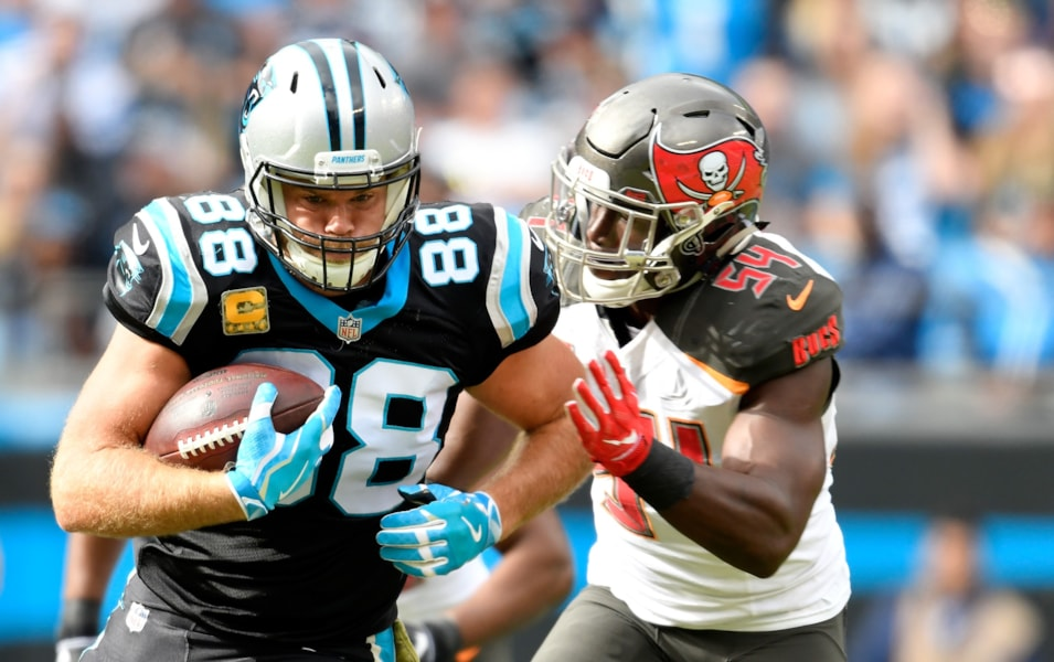 CHARLOTTE, NC - NOVEMBER 04:  Greg Olsen #88 of the Carolina Panthers runs the ball against Lavonte David #54 of the Tampa Bay Buccaneers in the second quarter during their game at Bank of America Stadium on November 4, 2018 in Charlotte, North Carolina.  (Photo by Grant Halverson/Getty Images)