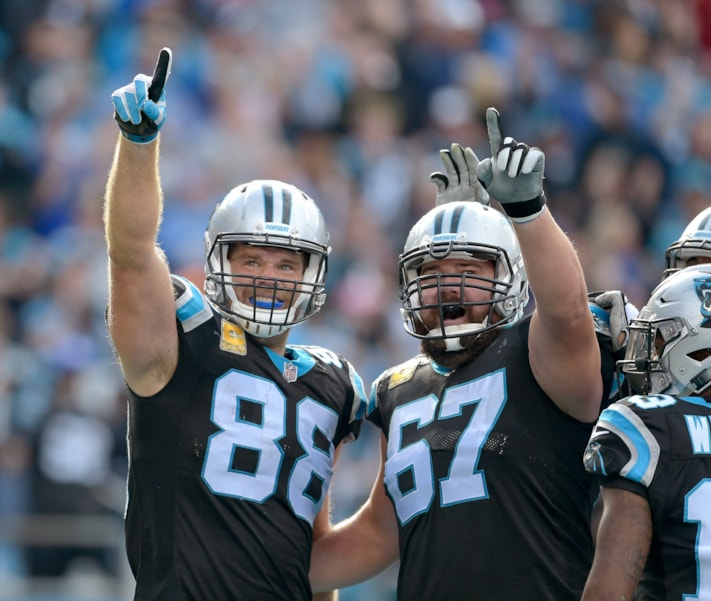 CHARLOTTE, NC - NOVEMBER 04:  Greg Olsen #88 of the Carolina Panthers celebrates with Ryan Kalil #67  after scoring a touchdown against the Tampa Bay Buccaneers during the first half of their game at Bank of America Stadium on November 4, 2018 in Charlotte, North Carolina.  (Photo by Grant Halverson/Getty Images)