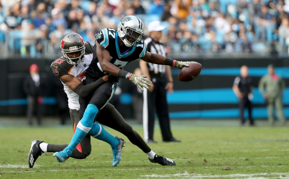 CHARLOTTE, NC - NOVEMBER 04:  Devin Funchess #17 of the Carolina Panthers runs the ball against Carlton Davis #33 of the Tampa Bay Buccaneers in the fourth quarter during their game at Bank of America Stadium on November 4, 2018 in Charlotte, North Carolina.  (Photo by Streeter Lecka/Getty Images)