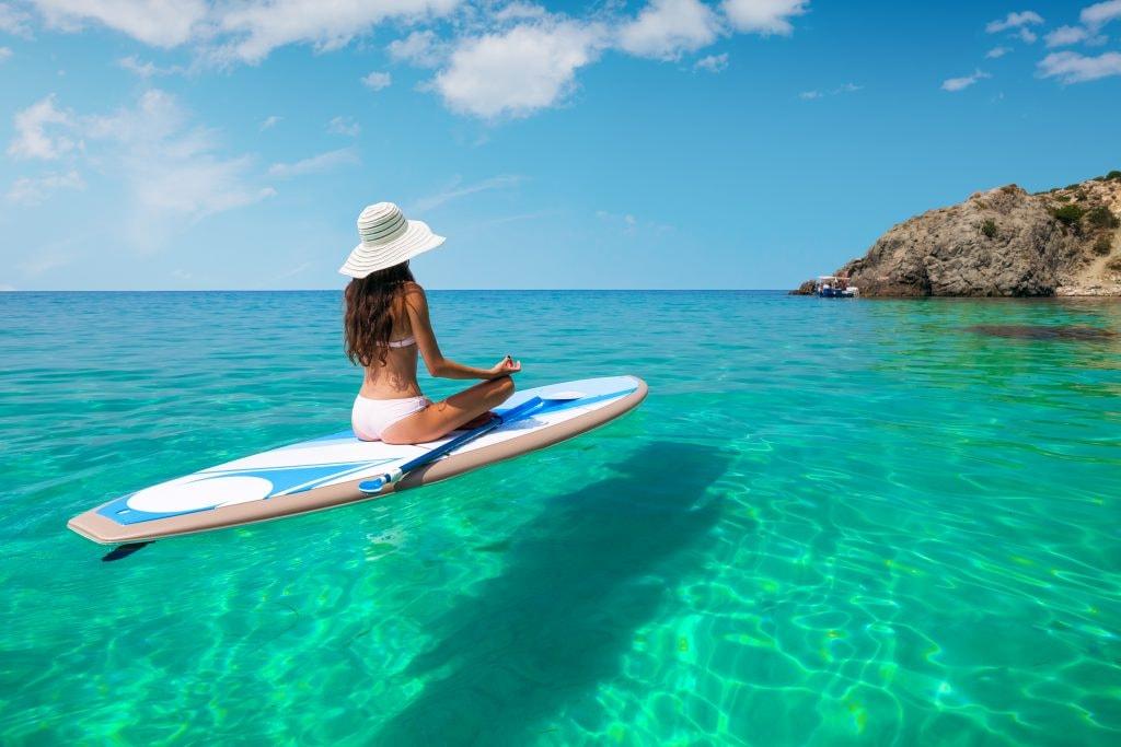 Woman on paddleboard in Hawaii